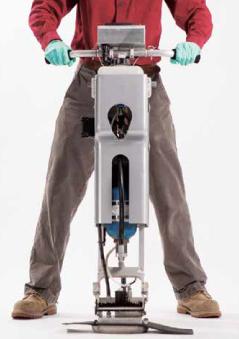 Man with machine stamping ground